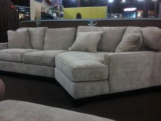 """I NEED a piece similar to this - must have this """"cuddler"""" piece of the sectional.  The lilhousethatcould.com says it's a Jonathan Louis piece, but I have trouble finding it here."""