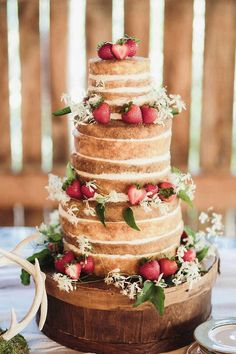 """Naked"" rustic wedding cake with strawberries"