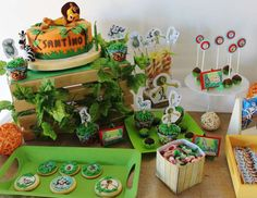 Adorable boy's 1st birthday party with Madagascar themed table setting