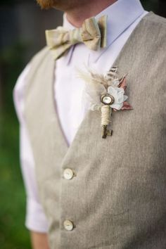 Groomsman bout with feathers and vintage embellishment.