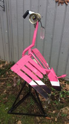 Welded metal flamingo from a shovel, bike parts and acrylic. Scare Heron