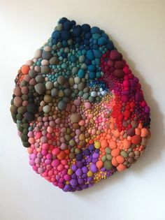 """Chilean artist Serena Garcia Dalla Venezia creates intricate textile sculptures by hand-sewing and combining several balls made of fabric.  """"Appearing almost like organic growths, her works seem to be transforming before your eyes, which makes sense when you consider her fascination with accumulation and chaos.""""  More art on the grid via Colossal"""