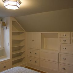 Attic Bedroom Design Ideas, Pictures, Remodel, and Decor - page 6 Shelves and dressers built into the knee wall to maximize floor space.  Awesome.