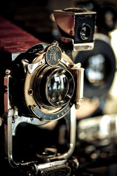A beautiful shot of an outstanding vintage Kodak camera. Note the gold-tone details in the lens housing and the red bellows. Looks to have been well cared for.