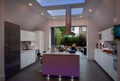 Kitchen with hidden lighting design in a contemporary Victorian terrace home in London by NS Interiors