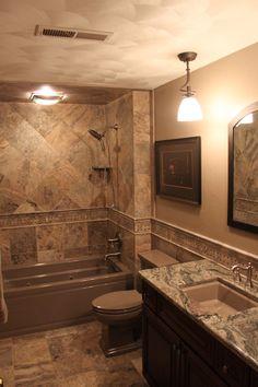 What a classy bathroom remodel - amazing tile work!    Midwest Stone Source + Design Studio   815.395.8677   #bathroom #granite #tile #RockfordIL #MidwestStoneSource MidwestStoneSource.com