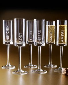 "Six ""Celebration"" Champagne Flutes at Neiman Marcus."