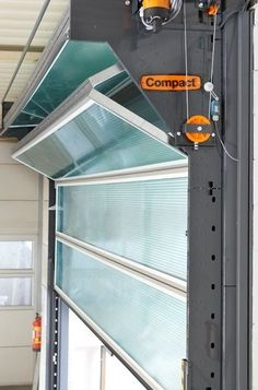 The Compact Industrial Door, Rolflex - this way you have more ceiling storage space in your garage. It also solves the problem of a wet garage door dripping on everything inside when open. Industrial Door, Industrial Interiors, Industrial Closet, Industrial Bookshelf, Industrial Apartment, Industrial Bathroom, Industrial Living, Warm Industrial, Industrial Wallpaper