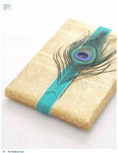 DIY Peacock feather gift wrap I created for Emily Henderson's holiday mag.