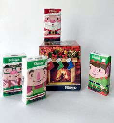Kleenex Christmas boxes designed by Design Bureau   graphic design. visual communication. packaging. package design. label design. branding. layout. hierarchy. holiday packaging.