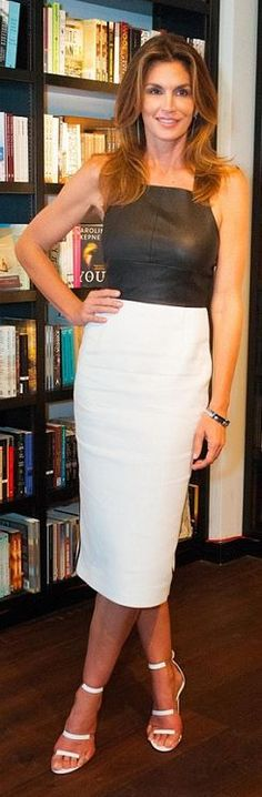 Who made Cindy Crawford's black leather top, white skirt, and sandals?