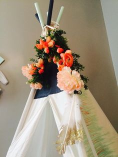 Flower teepee garland - such a cute accent on this teepee in the nursery!