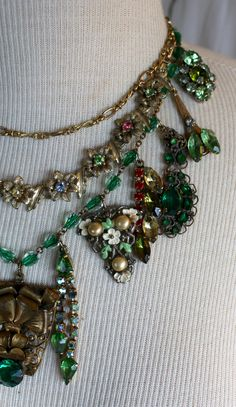 Stunning, statement, and glamorous are some of the ways to describe this amazing green rhinestone collage necklace. I have been collecting vintage, antique and Victorian era memorabilia for a long time and I truly enjoy selecting these beautifully crafted bits of the past to make these stunning, over the top statement necklaces. Being able to repurpose and up-cycle small elegant bits of the past is the wonderful culmination of searching for these lovely trinkets. A bit of a salvaged…