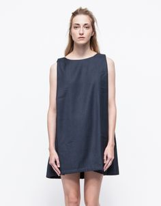 From the chic, pared down stylings of Kaarem, a relaxed and easy fit sleeveless dress with open back styling. Features elegant geometric caped back paneling, and single button back closure, with a full interior lining.   •Elegant open-back dress •Sin