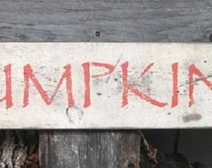 "Primitive Sign - Pumpkins - Great for Thanksgiving  or Halloween - 5.5"" x 24"" - White with Orange Lettering"
