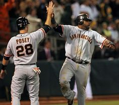 Buster Posey and Pablo Sandoval celebrate after scoring off a Brandon Belt double in the 9th inning against the Oakland Athletics during their MLB Baseball Game on Friday June 22, 2012 at the Oakland Coliseum, in Oakland California. Photo: Lance Iversen, The Chronicle / SF