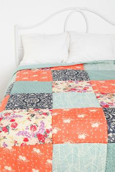 orange and blue patchwork quilt