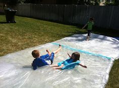 "Giant ""water bed"" outside sensory bag- buy plastic drop cloths and ducktape and fill with water (under $10 all together) this mom said it provided all-day fun!"