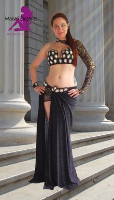 Classical yet modern black belly dance costume, unique design by Makari Dreams. Decorated with amazing tear drop crystals. www.makaridreams.com