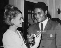 Portuguese footballer Eusebio at a reception for his team, Benfica, at the Burberry store in Haymarket, London 30th May 1968. With him is 'Miss Burberry', Patricia Neane. (Photo by Mike McLaren/Central Press/Hulton Archive/Getty Images)of Benfica