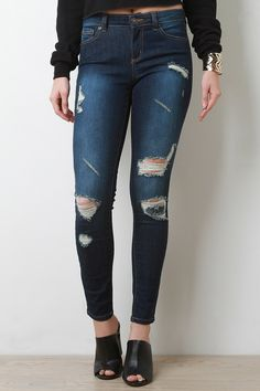 @modaonpoint These jeans feature dark wash denim design, distressed accents, belt loops, 5-pocket design, zipper fly with single button closure, and taper cut legs. Accessories sold separately. 75% Cotton, 23% Polyester, 2% Spandex.