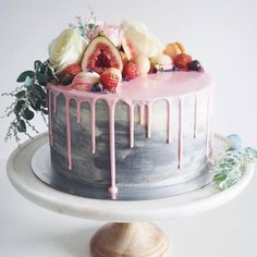 Gorgeous marbled dripping cake with fruits & flowers on top