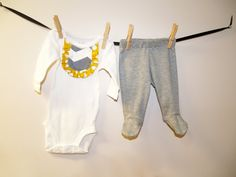 Adorable mustard and gray chevron applique ruffle bib bodysuit with gray footed pants. Dress your little lady in comfort and style when you bring
