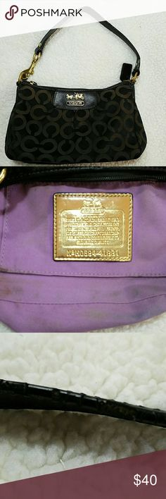"""AUTHENTIC Coach Madison Mini Bag 41991 Beautiful little bag in black with brown logo C. Goldtone hardware.  No rips in lining or outside canvas. Has signs of wear: handle leather is a little worn, hardware a little discolored, lining has some makeup and discoloration from use. Please see pictures. Can be cleaned or used as is. Wear is not very noticeable. Please ask questions if you have any. Approx 8"""" wide 5 and 1/2"""" high  and 11"""" from top of handle to bottom of bag Coach Bags Mini Bags"""