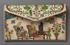 Pocketbook  c1715 French Dimensions Overall: 3 15/16 x 6 5/16 x 9/16 in Accession Number 43.2343 Medium or Technique Glass beads strung on linen (sablé); woven silk and metallic thread.  On cardboard foundation.