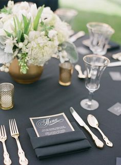 Fold the napkin into a square, leaving a little sleeve to tuck the napkin into | Brides.com
