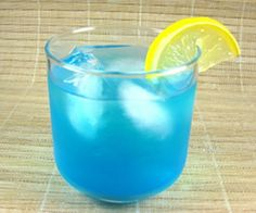 The Blue Lagoon cocktail is blue, ever so slightly frothy and totally citrus in flavor.