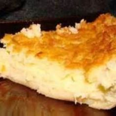 My good friend & co-worker, Colleen, used to bring this pie to our company pot-lucks.  It disappeared like new fallen snow every time, and sometimes caused a scuffle or two...it is that good!!  Before she retired she shared the recipe with a few of us.  My husband can eat the whole thing in  1 night!  On top of that, it is easier than most of the coconut custard pie recipes, so it is a win/win!!