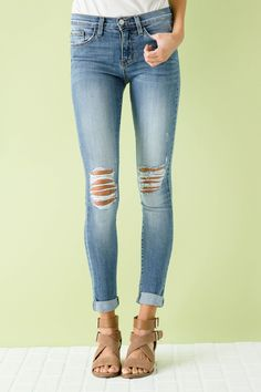 Our Lunch Break Flying Monkey Skinnies feature a standard 5 pocket style, front button enclosure, and a medium wash denim, knee distressing, and gold stitching. - Unlined - 73% Cotton. 14% Rayon. 11%