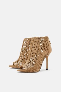 776da968650 Natural colored heeled sandals. Woven exterior. Peep toes. Thin  fabric-covered heel