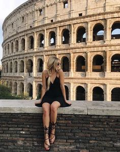 I like this picture because even though the girl is the focus, the Colosseum brings a lot of attention to the picture. It adds more interest into a picture rather than just a normal picture of a girl sitting on a wall.