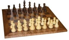 Amish Handcrafted Chess Board Game Have a delightful time with an old fashioned favorite. This deluxe chess board is made from solid wood.