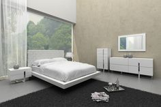 Modrest Voco Modern White Leatherette Eastern King Bed VGCN1301-B2Product : 16988/16989Features :Modern white bed with crosshatch leatherette patterned headboardSafe rounded bed frame cornersAdditional bedroom set pieces availableWhite matte finish and stainless steel accents on case goodsDimensions :E. King Bed :W75