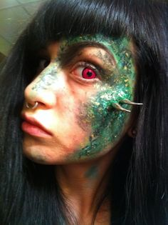 last minute work costume haha :)    Ben Nye Nose and Scar Wax and some clothing studs she actually looks like a dragon right! like her face looks like a dragon too. cool lol