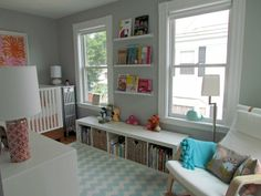 Grey walls/white trim livened up with bright colours in accessories.