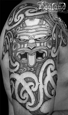 Finding a good depiction of Ben's Tiki Tattoo was harder than I thought it would be. This Tiki image is as close to the design I had in my mind when I pictured Ben's on his arm. A Tiki surrounded by traditional Maori tribal design, except Ben's covers his entire arm.