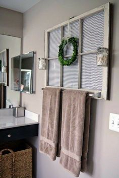 Use a repurposed window in a windowless bathroom....I might add a mirror behind it!