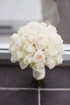 Classic creme white roses. Simple and elegant. Very pretty.