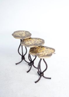 Septarian Nodule Nesting Tables on a twig and vine inspired iron base. Tables can be sold as a set or individually. Customize your space with a variety of stone tops and patina finishes. 818-765-3755 x103 mickmael@michalandcompany.com #sidetable #nestingtables #accenttable #tables