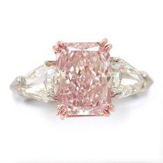 FANCY PINK RADIANT CUT DIAMOND RING. 4.08 CARATS.