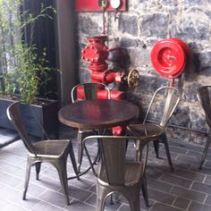 Tolix style chairs at Imperial Lane cafe, Auckland.