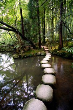 Stone walk over the Pond at Tenjuan Temple, Nanzen-ji Temple complex - a Zen Buddhist temple in Kyoto, Japan