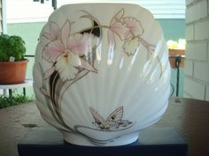Vintage Fine Bone China Japan Vase with Soft Pink Iris Butterfly.  Beautiful art deco style with Soft Pink Iris Vase design, has black accents, and green leaves. A butterfly rests at the bottom of thi