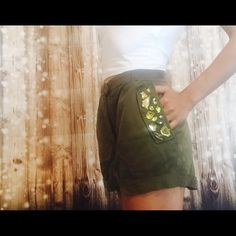 Army green jeweled embellished shorts Given to me by a friend for a birthday. But not my style! Quick sell! True to size! This is from H&M conscious collection. Difference in color is due to lighting. 2-3 pic was in bedroom 4 was in my make up room with lighting H&M Shorts