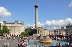 Trafalgar Square. Trafalgar Square is a large city square commemorating Lord Horatio Nelson's victory against Napoleon's navy at the Battle of Trafalgar in 1805. The central monument within the square is a single tall column on which the figure of Nelson stands gazing over London. His monument is surrounded by four colossal lions and a series of large fountains. Much more than just an open plaza, Trafalgar Square is one of the most famous city squares in the United Kingdom