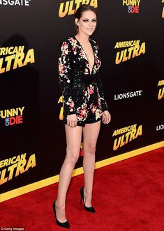Stunning display: The Hollywood star put on an impressive sartorial display in a plunging sequin jumpsuit which highlighted her slender figure - Kristen Stewart